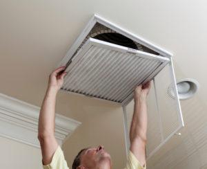man-changing-air-filter